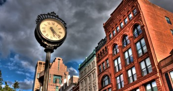 A clock along the street during an evening walk through downtown Louisville, Kentucky.